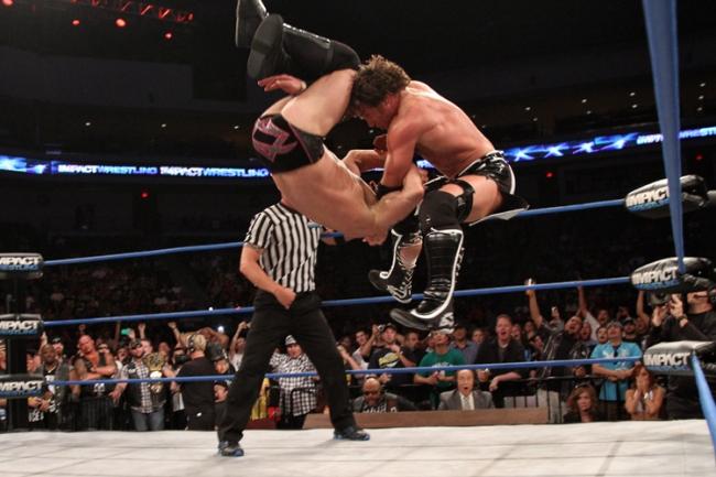 Chris Sabin hits Cradle Shock off the Top Rope