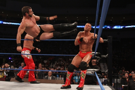 Austin Aries delivers his signature dropkick to Kazarian